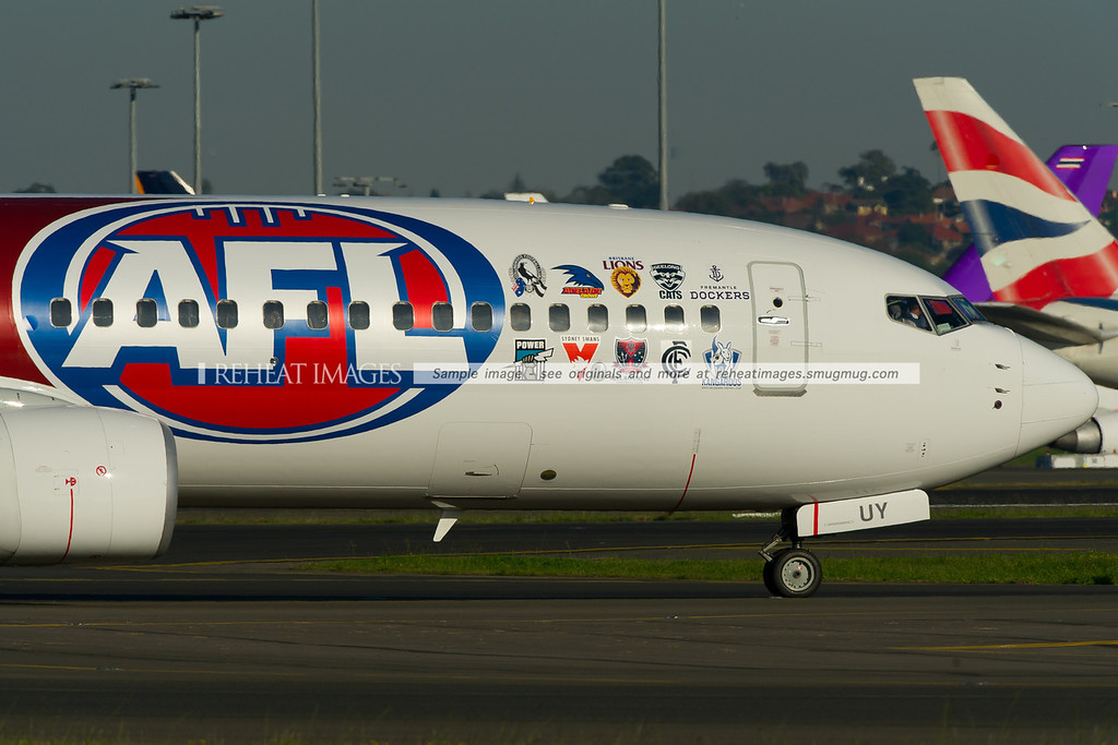 A close up of the football team logos on this Virgin Australia (Virgin Blue) B737-800 in the AFL colour scheme.
