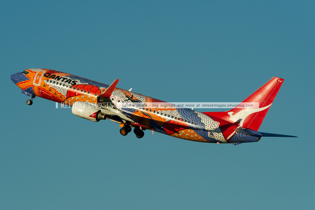"Qantas' B737-838 in a special colour scheme takes off from Sydney airport. The plane is named ""Yananyi Dreaming"". It was one of a number of special coloured Qantas planes including Wunala Dreaming (B747-438 and B747-438/ER) and Nalanji Dreaming (B747-338)."