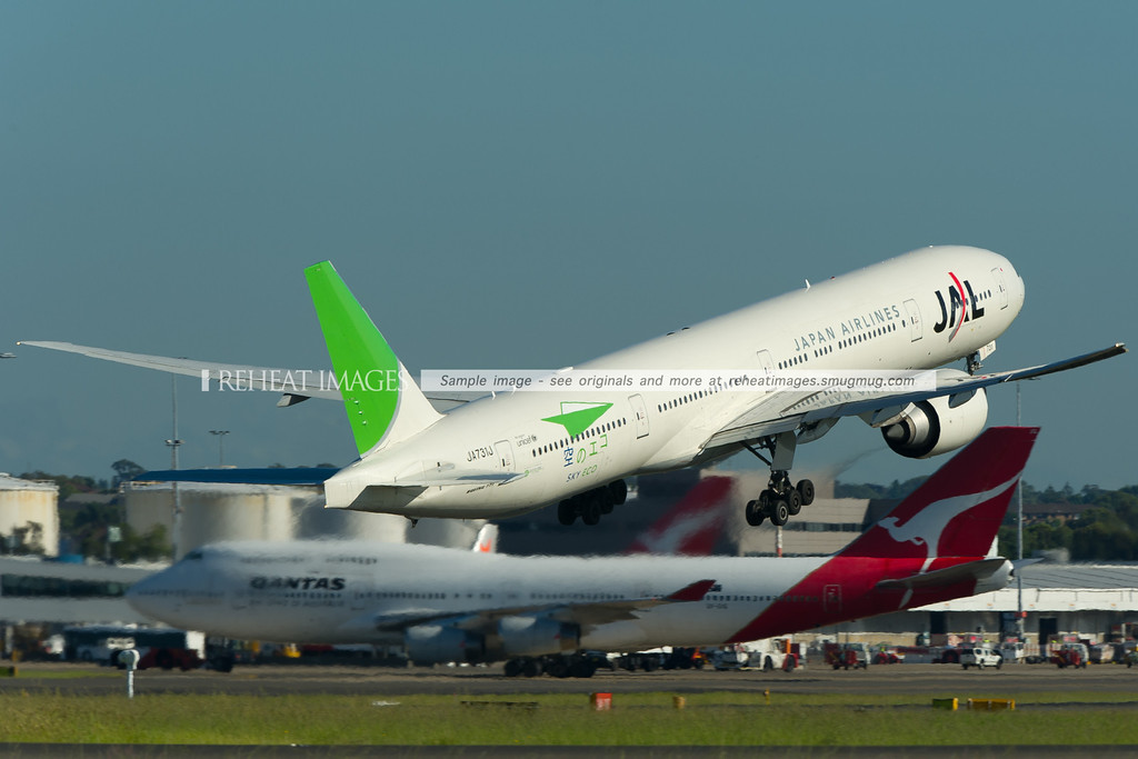 Japan Airlines Boeing 777-346/ER in a unique 'Sky Eco' colour scheme leaves Sydney. JA731J has a very green tail.