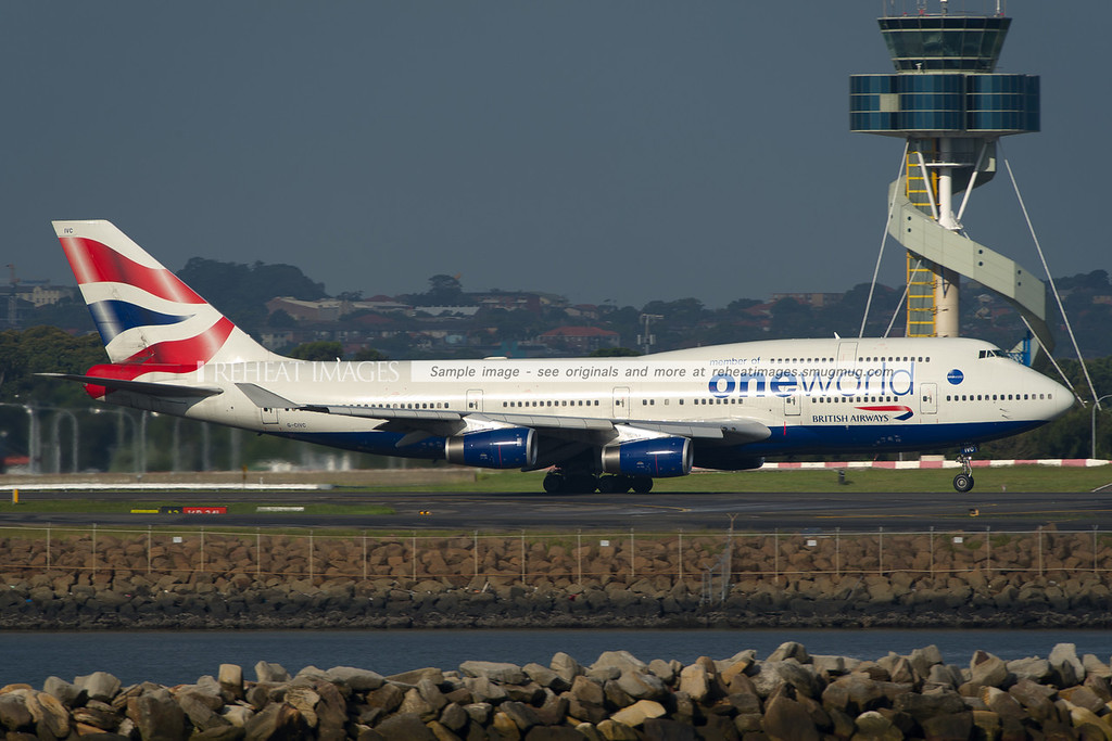 A British Airways Boeing 747-436 takes off from Sydney airport. This plane wears the OneWorld alliance logos in massive size.