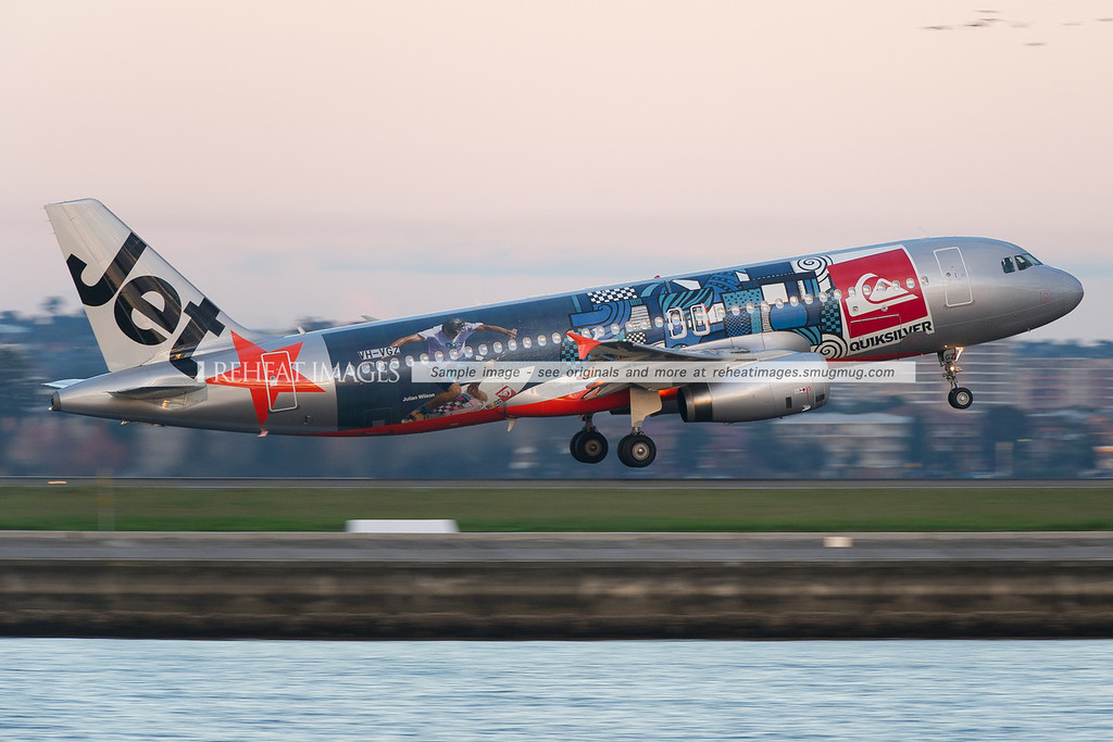 A Jetstar Airbus A320-200 in the special Quiksilver colour scheme takes off from runway 34 right at Sydney airport.