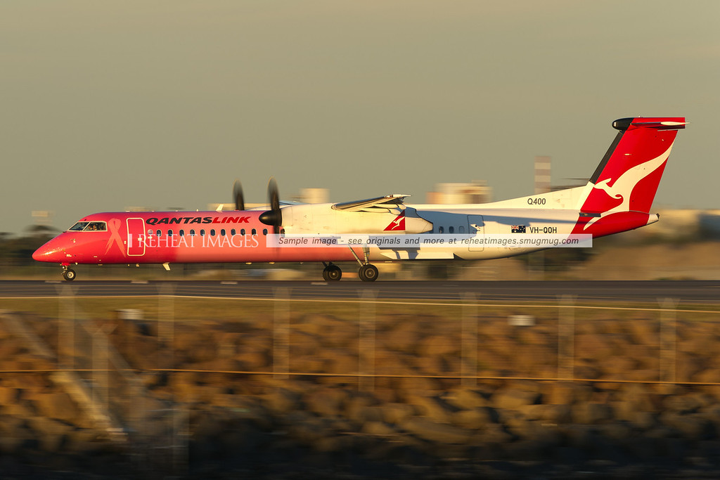 QantasLink Dash 8 Q400 takes off from Sydney airport. This aircraft wears special colours in support of cancer research.
