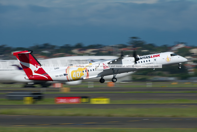 QantasLink Dash 8 Q400 VH-QOI departs Sydney wearing the Destination Tamworth colour scheme promoting the Tamworth Country Music Festival.  Slow shutter speed courtesy of 8x neutral density filter adds the impression of speed.