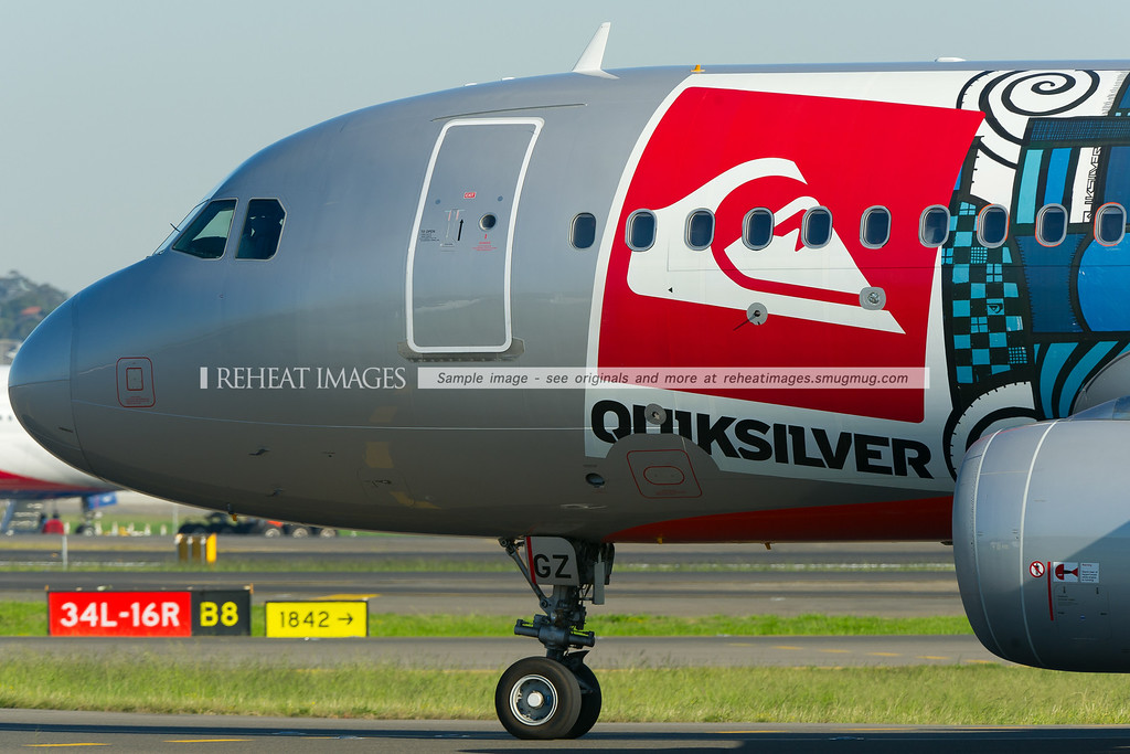 A Jetstar Airbus A320-200 in the special Quiksilver colour scheme taxies to runway 34 right at Sydney airport.