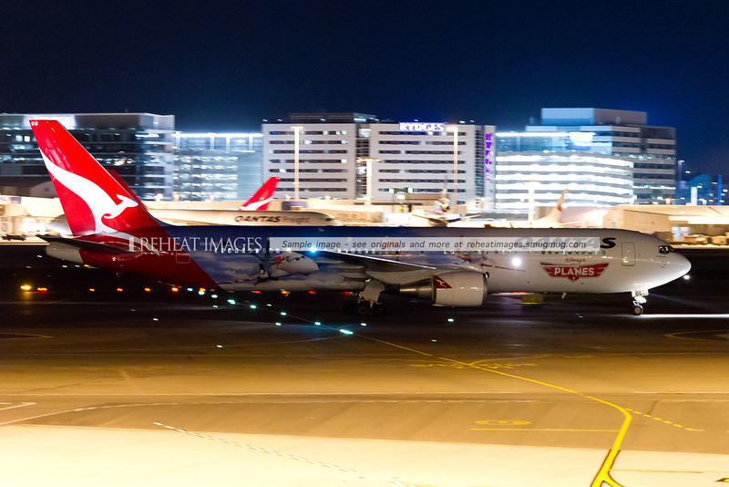 Qantas B767-338/ER VH-OGG at Sydney Airport on 22 September after arriving from Darwin. It is seen here with the elaborate Disney Planes colour scheme.