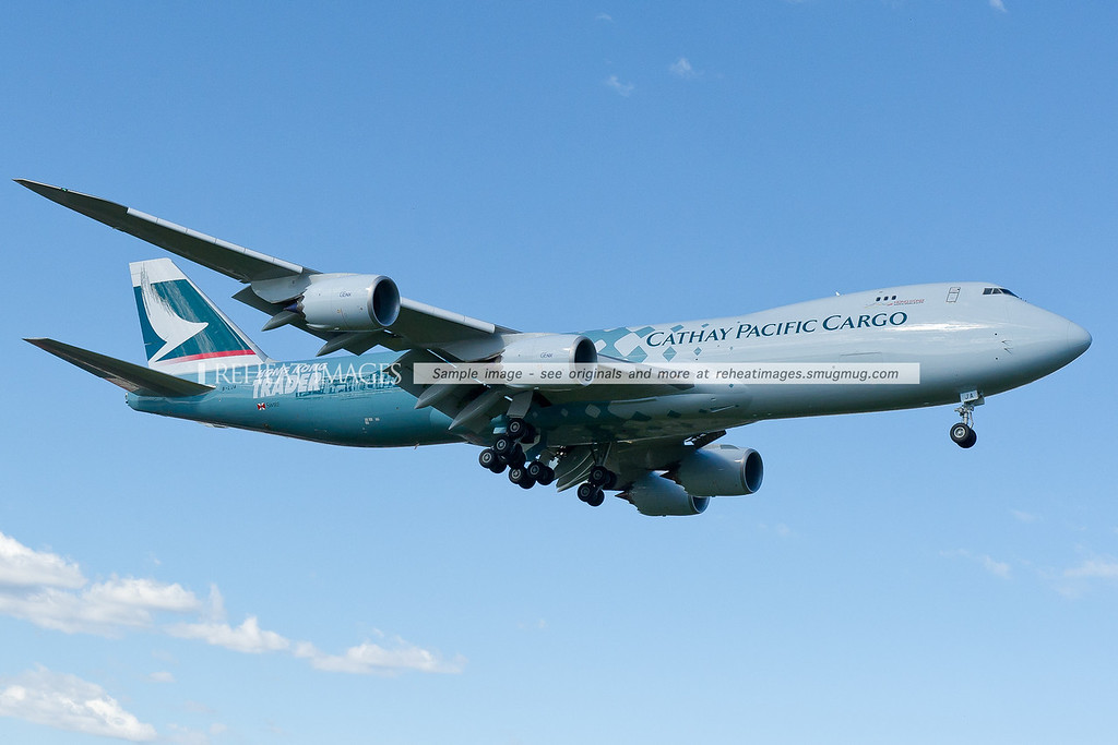 Cathay Pacific Cargo's brand new Boeing 747-867F in the Hong Kong Trader colour scheme arrives into Sydney marking the first ever visit of a Boeing 747-8 into Sydney airport. B-LJA is the registration of this aircraft which is powered by very quiet GEnx engines. Compared with a traditional B747-400F, this plane is longer, has different engines and a radically different wing.