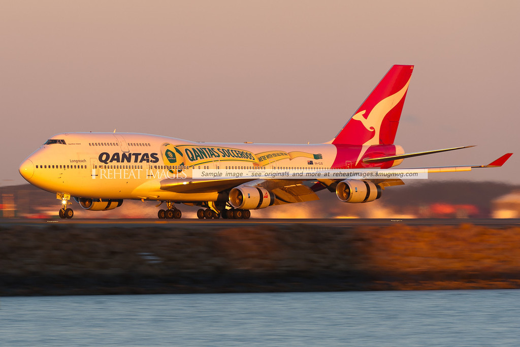 A Qantas B747-438 arrives at Sydney airport wearing a special colour scheme promoting the Qantas Socceroos football team.