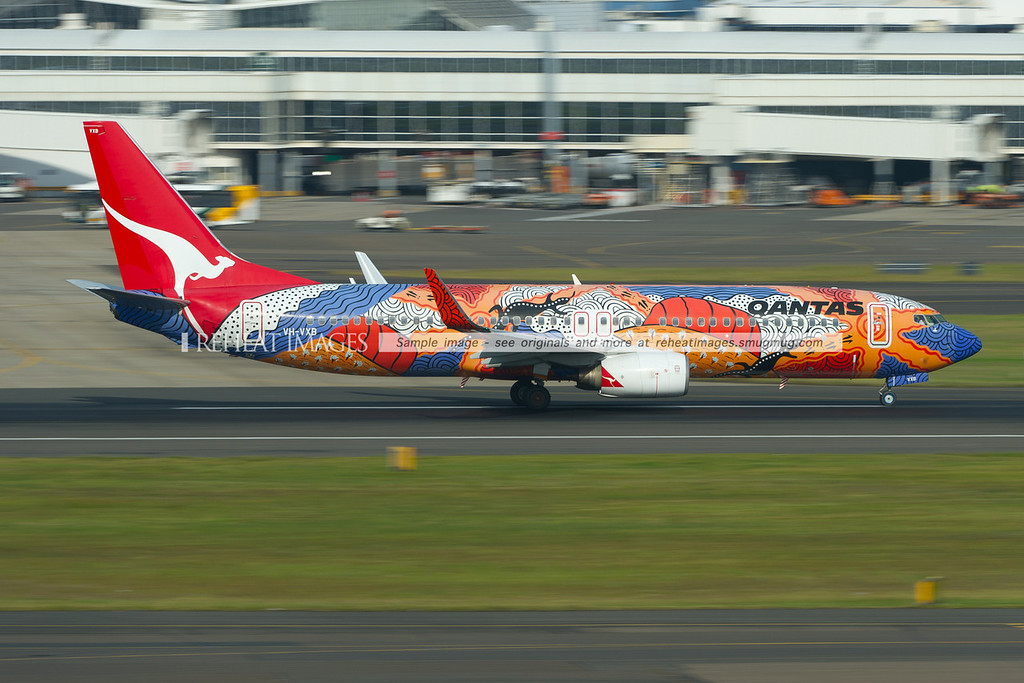 "Qantas Boeing 737-838 ""Yananyi Dreaming"" takes off from Sydney airport."