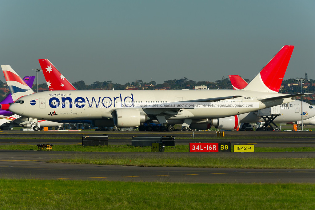 Japan Airlines Boeing 777-246/ER in the OneWorld colour scheme taxies out to runway 34 left at Sydney airport.