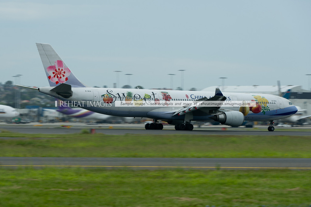 "A China Airlines Airbus A330 arrives in Sydney wearing a special colour scheme ""sweet""."