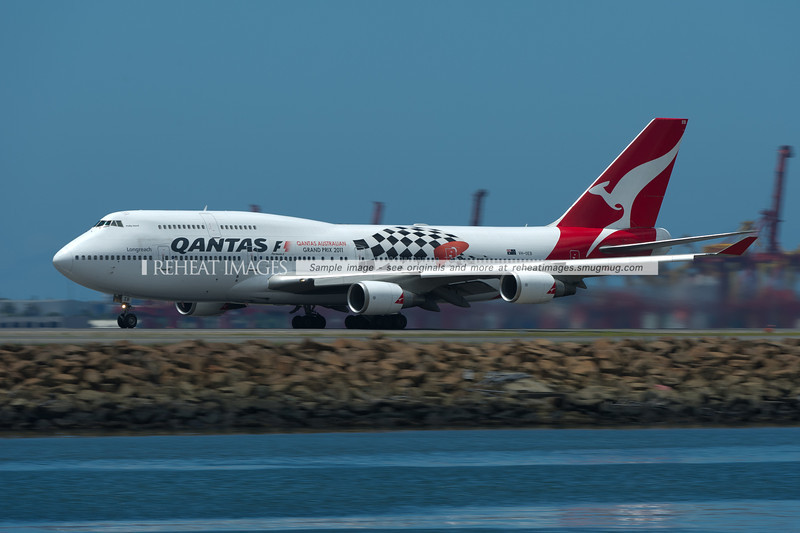 A Qantas Boeing 747-48E takes off from Sydney airport. This plane wears a promotional colour scheme for the F1 Qantas Australian Grand Prix 2011.