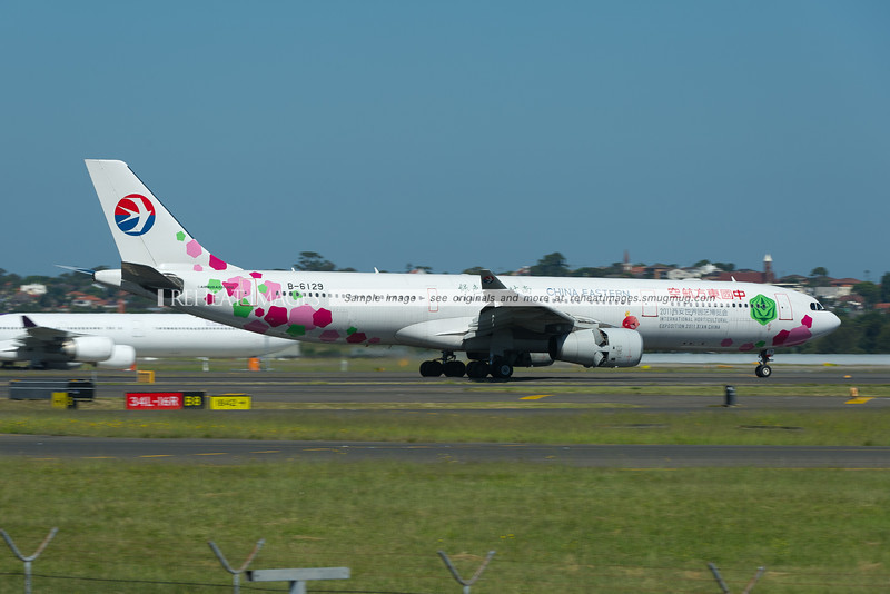 China Eastern Airbus A330-300 B-6129 arrives in Sydney. The plane carries a special colour scheme promoting the International Horticultural Exposition 2011 Xian China.