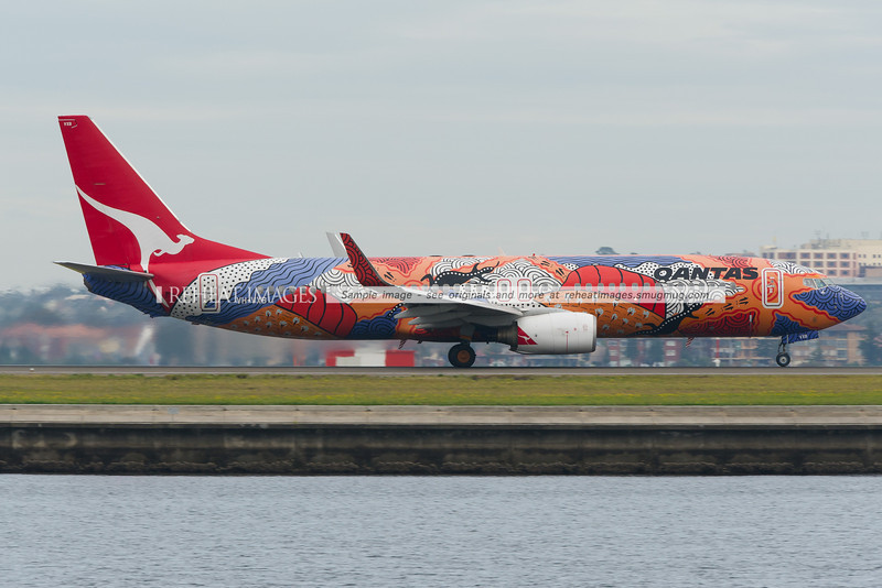 A Qantas B737-838 at Sydney airport. This plane wears a special Aboriginal colour scheme and is titled Yananyi Dreaming.
