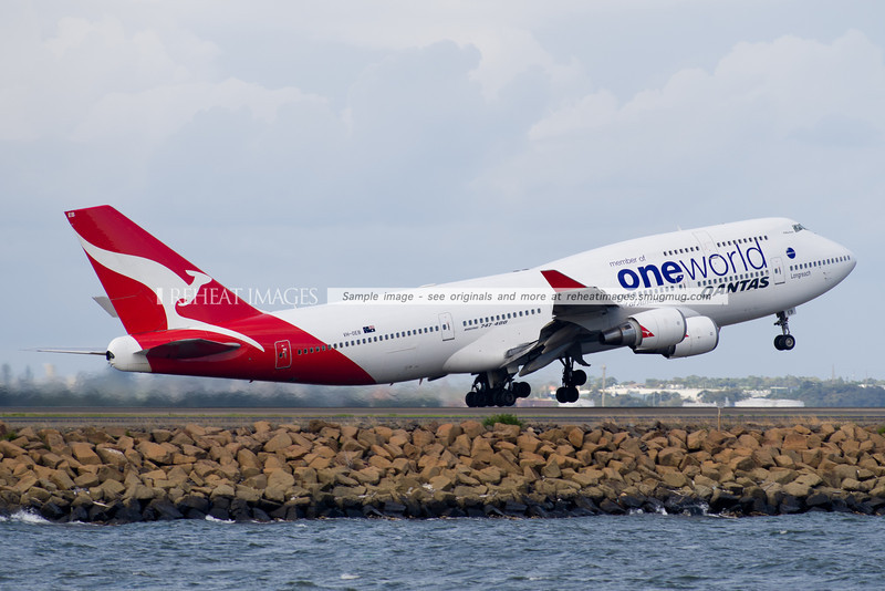 Qantas' Boeing 747-48E (ex Asiana) departs Sydney airport wearing the Oneworld alliance colour scheme.  The scheme has since been transferred across to B747-438 VH-OJU.