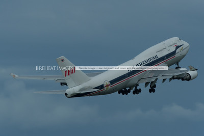 Thai Boeing 747-4D7 HS-TGP in the retro colour scheme departs Sydney on a gloomy afternoon.