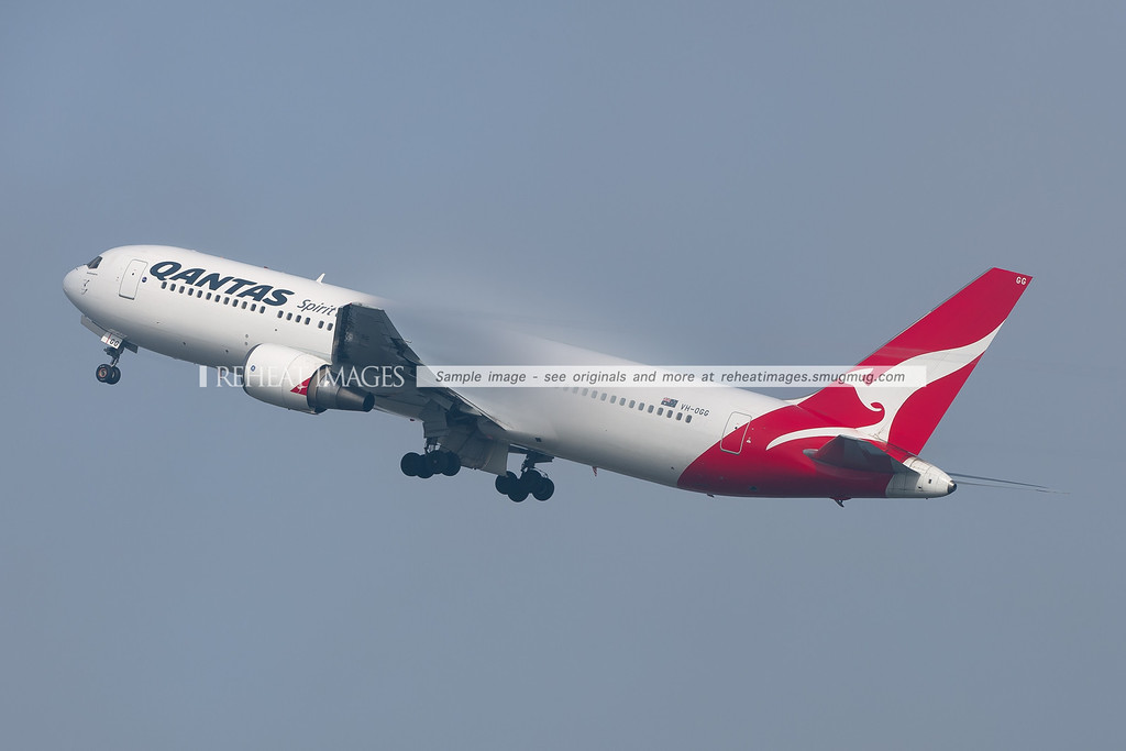A Qantas B767-338/ER takes off from Sydney as the fog starts to lift. But it still formed impressive condensation over the wings.