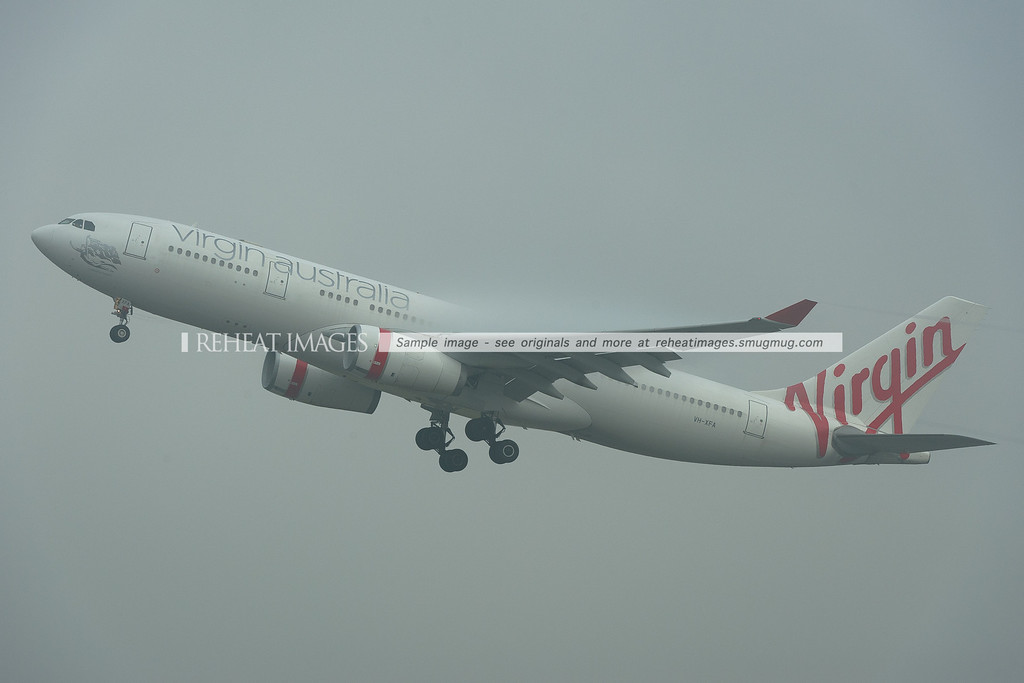 Virgin Australia Airbus A330-200 VH-XFA takes off from Sydney in heavy fog.