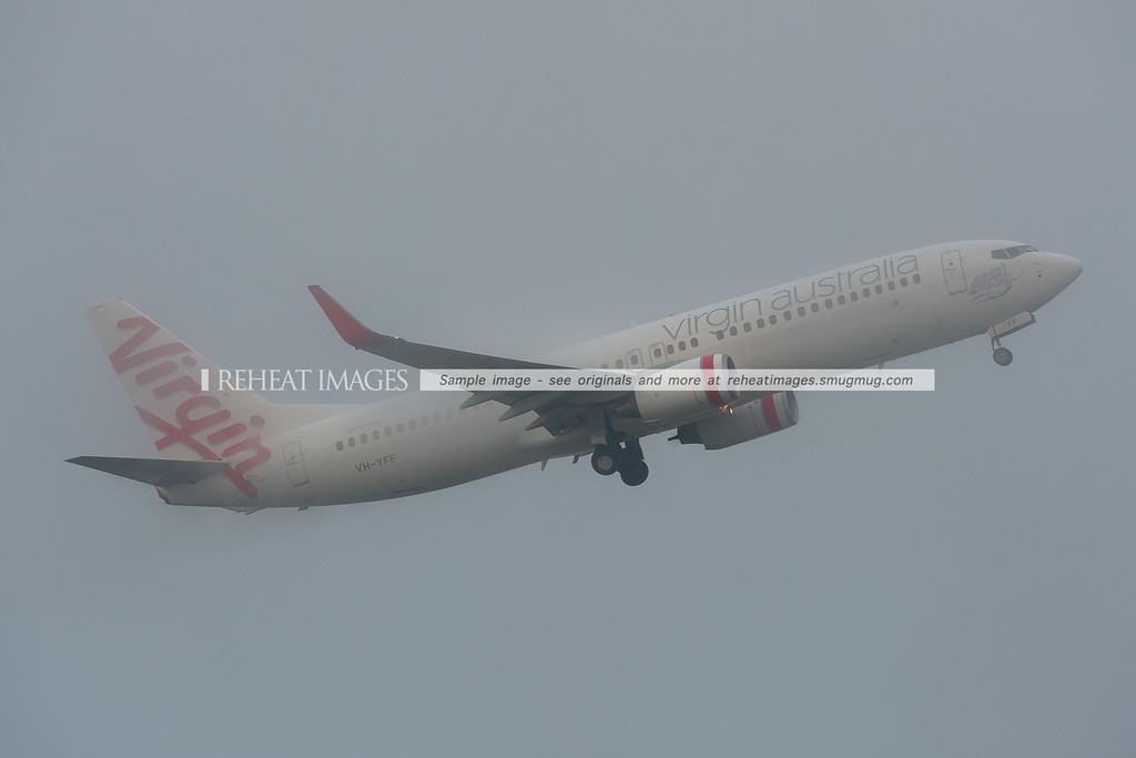 A Virgin Australia Boeing 737 takes off from Sydney in very heavy fog.