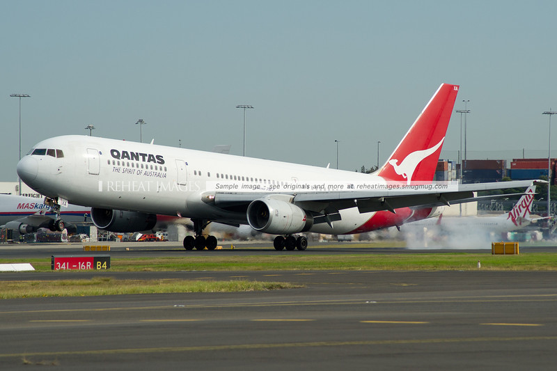 A Qantas B767-336 lands at Sydney airport.