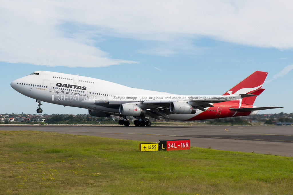 Qantas B747-438 VH-OJQ rotates from runway 16 right. This angle of a B747 taking off never ceases to be breathtaking.