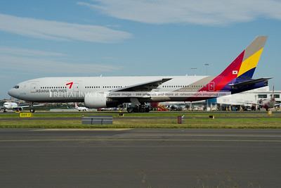 Asiana Boeing 777-200/ER takes off from runway 16 right.