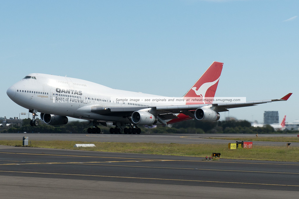 Qantas 63 lifts off from runway 16 right at Sydney airport.