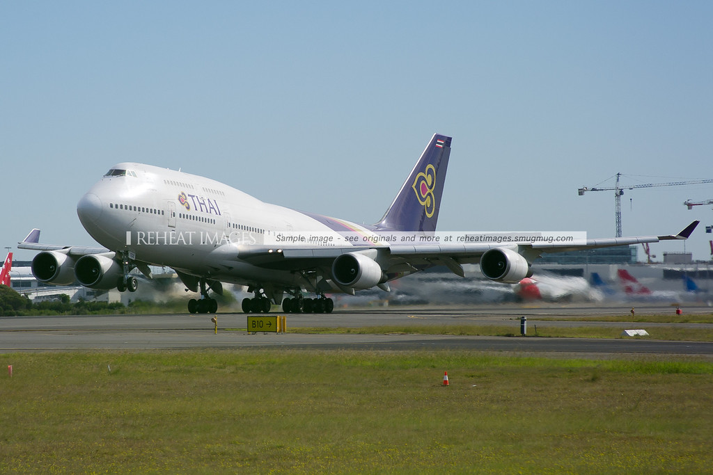 A Thai Boeing 747-400 lifts off from runway 16 right.