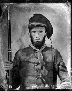 Confederate corporal, Army of the Confederate States, photographed at Pugh's Premium Photographic Portrait Gallery, Triangular Block, Macon, Georgia.