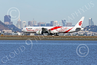 B777P 00467 A semi-rare color scheme Boeing 777 Air China SMILING CHINA B-2035 rolls out after landing at SFO with a San Francisco sky line background 12-2014 airliner picture by Peter J Mancus