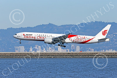 B777P 00476 A semi-rare color scheme Boeing 777 Air China SMILING CHINA B-2035 on final approach to land at SFO 12-2014 with Oakland in background airliner picture by Peter J Mancus
