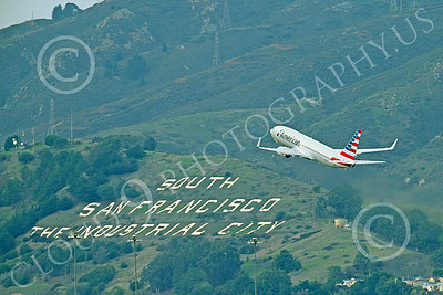 Boeing 737 00202 An American Airline Boeing 737 climbs out after taking off from SFO 12-2014 airliner picture by Peter J Mancus