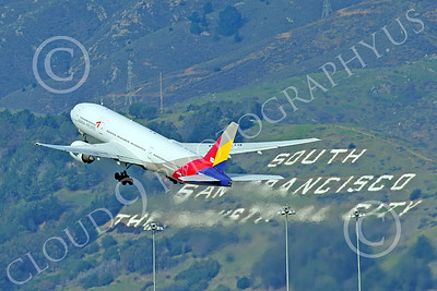 B777P 00506 A Boeing 777 Asiana Airline HL7739 climbs out after taking off at SFO 12-2014 airliner picture by Peter J Mancus