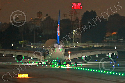 A380 00103 A twin engine Embraer EMB-120 Brasilia behind a China Southern Airbus A380 underscores the A380's enormous size, LAX at night 7-2013, jet airliner picture by Peter J Mancus