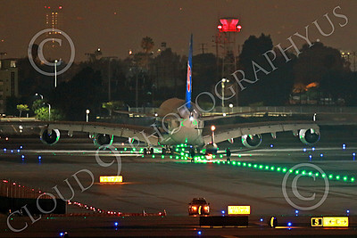 A380 00041 A twin engine Embraer EMB-120 Brasilia behind a China Southern Airbus A380 underscores the A380's enormous size, LAX at night 7-2013, jet airliner picture by Peter J Mancus