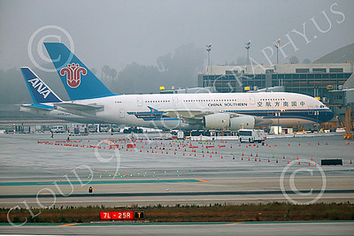 A380 00075 A static Airbus A380 China Southern B-6140 at a LAX passenger gate 7-2013 jet airliner picture by Peter J Mancus