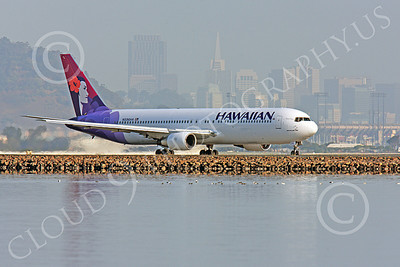 B767 00031 A Hawaiian Airline Boeing 767, N596HA, taxing for take-off at SFO, with the city of San Francisco in the background, airliner picture, by Peter J Mancus