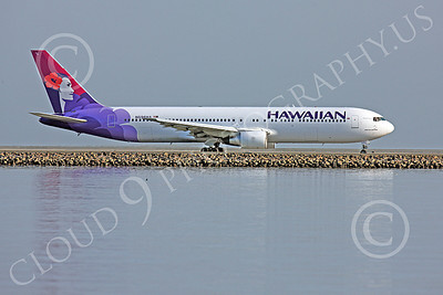 B767 00079 Right side profile of a Hawaiian Airline Boeing 767, N596HA, taxing for take-off at SFO under an early morning overcast, airliner picture, by Peter J Mancus