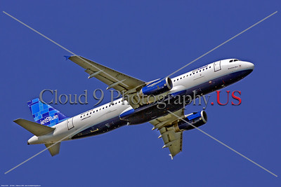 A320 00200 An Airbus A320 jet airliner, JetBlue N607JB, climbing out after taking off from McCarren airport in Las Vegas, 9-2006, jet airliner picture by Peter J Mancus     Dt
