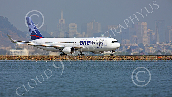 B767 00461 A LAN Airline One World Boeing 767 with winglets taxis at SFO, with San Francisco in the background, airliner picture, by Peter J Mancus