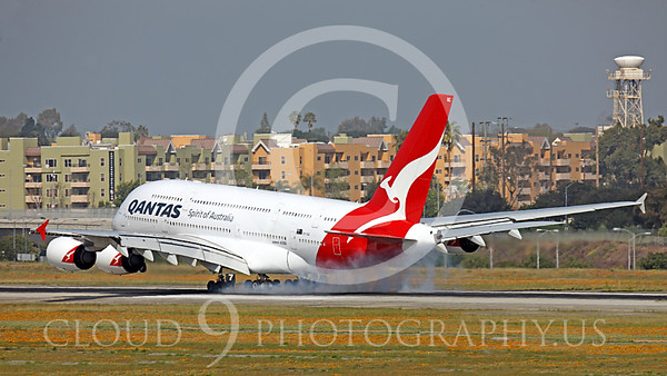 A380 00017 A Qantas A380 jumbo jet airliner's many tires give off a lot of burnt rubber upon landing at LAX, airliner picture, by Peter J Mancus