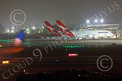 A380 00061 A Boeing 737 United Airline taxis pass two Airbus A380s Qantas at night at LAX 7-2013 jet airliner picture by Peter J Mancus