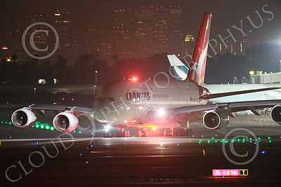 A380 00033 A taxing Airbus A380 Qantas with red strobe light at LAX at night 7-2013 jet airliner picture by Peter J Mancus