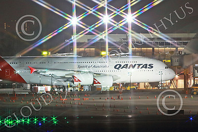A380 00051 A tight crop of a static Qantas' Airbus A380 jet airliner at a passenger gate at night at LAX 7-2013 jet airliner picture by Peter J Mancus