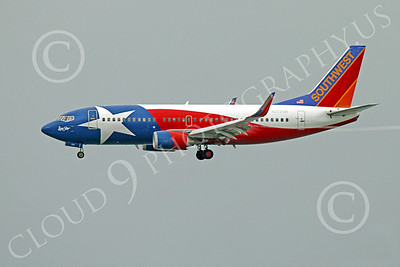 Boeing 737 00176 A colorful Southwest Airline Boeing 737 N352SW LONE STAR on final approach to land at SFO 12-2014 airliner picture by Peter J Mancus