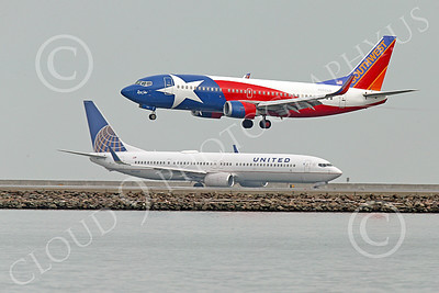 Boeing 737 00181 A colorful Southwest Airline Boeing 737 LONE STAR on final approach to land at SFO 12-2014 airliner picture by Peter J Mancus