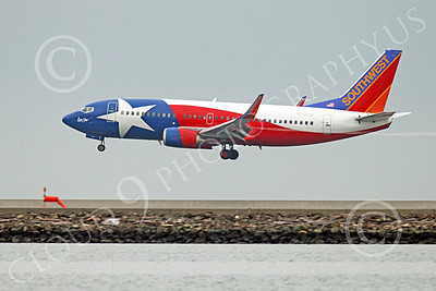 Boeing 737 00177 A colorful Southwest Airline Boeing 737 N352SW LONE STAR on final approach to land at SFO 12-2014 airliner picture by Peter J Mancus