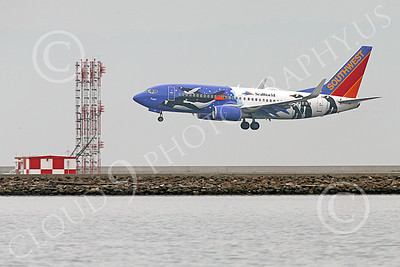 Boeing 737 00179 A colorful Southwest Airline Boeing 737 PENQUIN SEA WORLD on final approach to land at SFO 12-2014 airliner picture by Peter J Mancus
