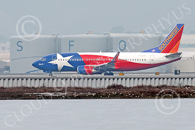 Boeing 737 00184 A colorful Southwest Airline Boeing 737 LONE STAR taxis at SFO after landing 12-2014 airliner picture by Peter J Mancus