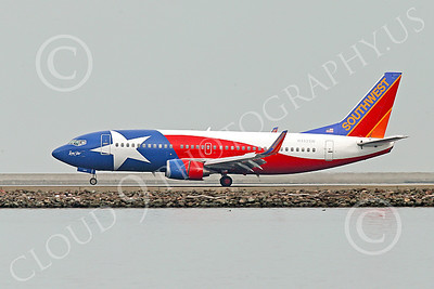 Boeing 737 00183 A colorful Southwest Airline Boeing 737 LONE STAR N352SW rolling out after landing at SFO 12-2014 airliner picture by Peter J Mancus