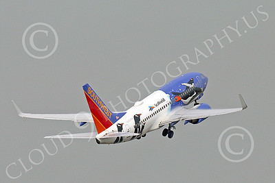 Boeing 737 00189 A flying colorful Southwest Airline Boeing 737 PENQUIN SEAWORLD 12-2014 airliner picture by Peter J Mancus
